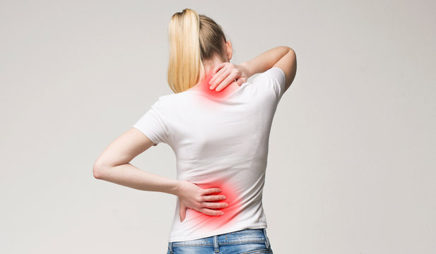 Scoliosis. Spinal cord problems on woman's back.