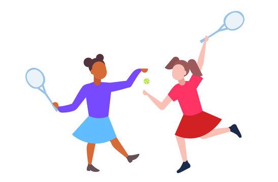 mix race schoolgirls playing tennis couple schoolchildren in sportswear having fun white background flat full length horizontal
