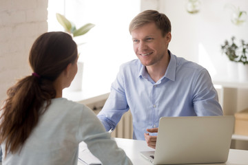 Cheerful man and woman at business meeting