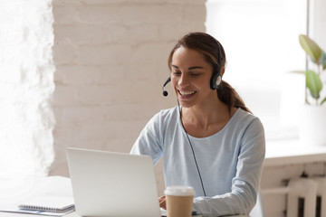 Beautiful smiling woman man working in headphones at office