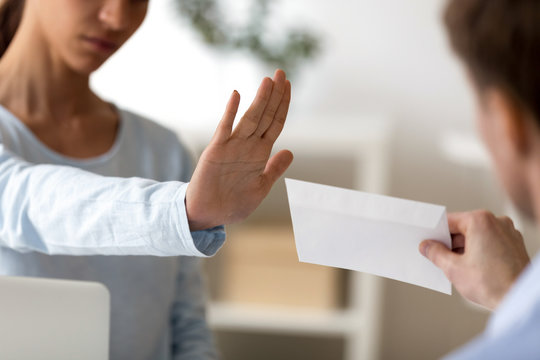 Woman refuse to take envelope with money close up