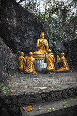 Statue of the Buddha and his disciples on the way up Mount Phusi in Luang Prabang, Laos