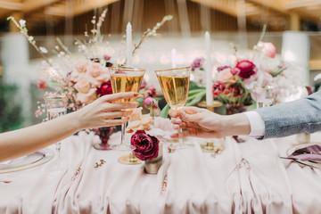 wine glasses in hand