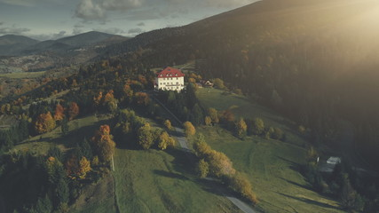 Mountain Village Wild Valley Aerial View. Multicolored Autumn Nature Hill Slope Landscape Overview. Panoramic Rural Highland Clean Environment Travel Concept. Zoom out Drone Flight