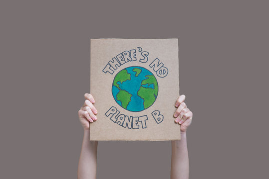 """Hands holding """"there is no planet b banner"""" isolated from the background, fridays for future"""
