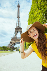 solo traveller woman against clear view of Eiffel Tower