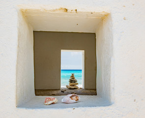 Rocks and shells stacked in the window on Caribbean Beach