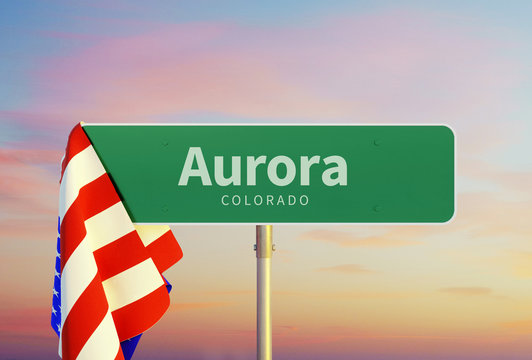Aurora - Colorado Road or Town Sign. Flag of the united states. Sunset oder Sunrise Sky