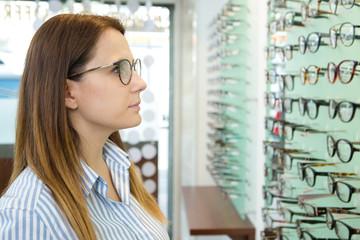 woman browsing a display of eyeglasses
