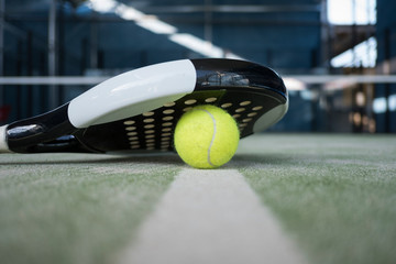 Paddle tennis racket and balls still life