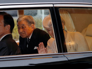 Japan's Emperor Akihito and Empress Michiko are seen inside a car upon arrival at Ujiyamada Station for their visit to Ise Jingu shrine, ahead of Emperor Akihito's April 30, 2019 abdication, in Ise