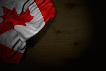 beautiful dark picture of Canada flag with big folds on dark wood with empty place for content - any feast flag 3d illustration..