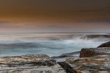 Rock Platform Sunrise Seascape with Light Smattering of Clouds
