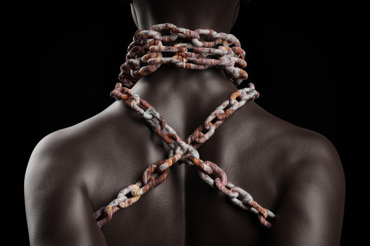 Female afro american slave with heavy rusty chain around her neck