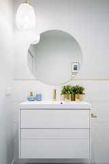 Bathroom with round mirror