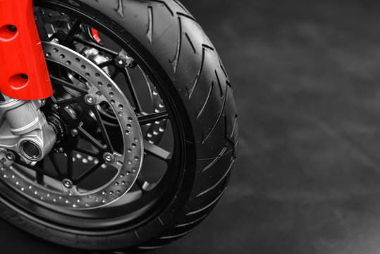 wheel of red sport motorcycle