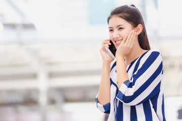 Businesswoman worker talking on smartphone