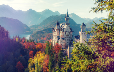 impressively beautiful Neuschwanstein Castle in warm sunlight