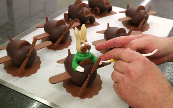 Belgian pastry cook Christophe Roesem decorates chocolate eggs at a Wittamer chocolate workshop ahead of the Easter weekend in Brussels