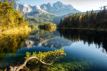 Incredible Autumn landscape The Eibsee Lake in front of the Zugspitze under sunlight. Amazing sunny day on the mountain lake. top place for photography. Eibsee lake in Bavaria, Germany