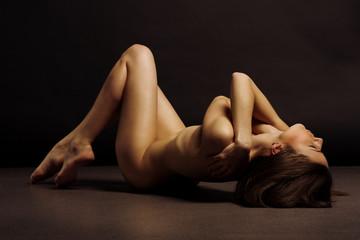 Fototapeta Beautiful back of young woman over dark background obraz