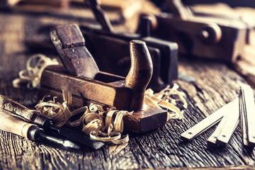 Obraz Old planer and other vintage carpenter tools in a carpentry workshop - fototapety do salonu