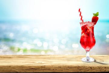 Summer drink on desk and sea landscape