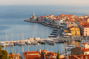 Skyline of Piran port and colorful houses during sunrise, Slovenia