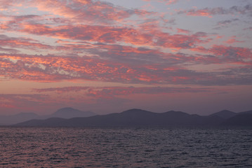 Blue Sky with red clouds. Sea nature sunrise concept Fototapete