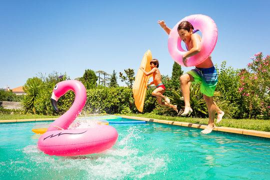Happy friends enjoying pool party in summer