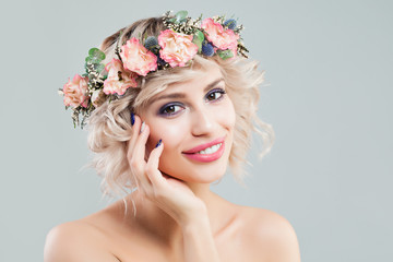 Beauty Fashion Portrait of Beautiful Model Woman with Curly Hair, Makeup and Flowers Crown