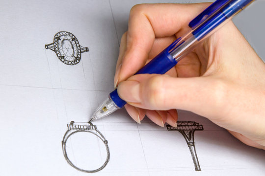 Drawing Jewelry Design. Artist designer drawing sketch jewelry on paper . Hand made.