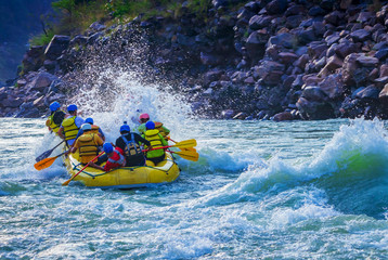 White water river rafting in Rishikesh, India. Sports activity by group of tourist.