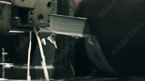 Dark Lighting Metal Cutting Machine With A Water Jet Cuts A