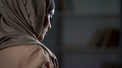 Unhappy arab woman in hijab close-up, pessimistic mood, sorrow, melancholy