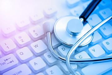 Fototapeta Stethoscope on computer keyboard obraz