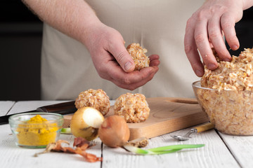 homemade meatballs with cheese, garlic and black pepper on the wooden chopping board