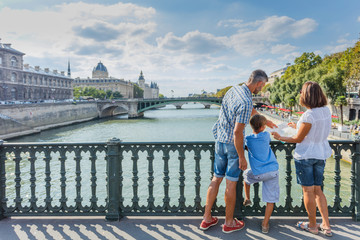 Happy family of three enjoying vacation in Paris, France