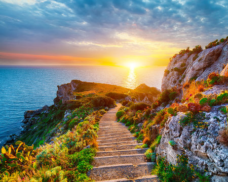 Dramatic spring sunset on the the cape Milazzo panorama of nature reserve Piscina di Venere.