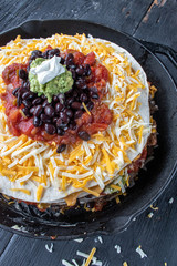 mexican tortilla with layers of cheese and beans