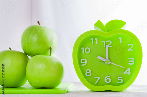 Alarm Clock And Green Apples On White Wooden Table Good Morning