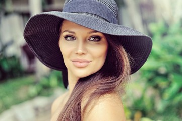 Amazing chic woman in black hat - close up
