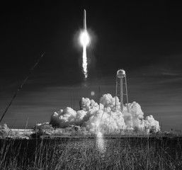 The Northrop Grumman Antares rocket with Cygnus resupply spacecraft onboard, is seen in this black and white infrared photograph as it launches from NASA's Wallops Flight Facility in Virginia