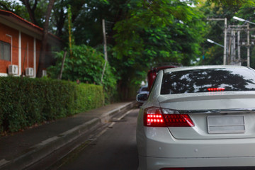 Fotomurales - luxury white car driving on green city road