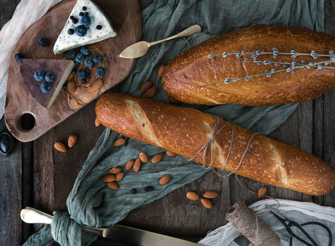Artisan bread with cheese, nuts and blueberries