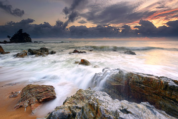 Wall Mural - Rushing waves over the rocky beach in Pantai Kemasik, Terengganu Malaysia