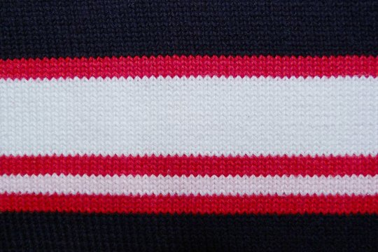 striped knitted knitted closeup background black red white