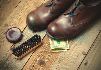 boots, brush, shoe polish and dollar