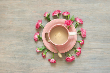 Cup of creamy coffee with flowers decor