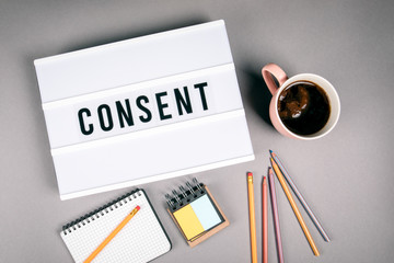 Consent. Text in light box. Pink coffee mug on gray background